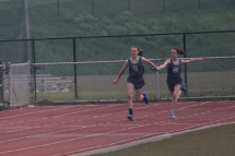 Peyton L. hands off to Hailey J. - 11/12 400 Meter Relay