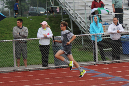 Aidan R. anchoring the 11/12 Boys 400 Meter Relay
